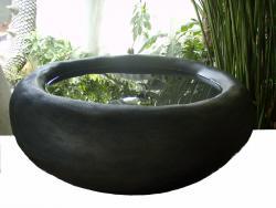Lavamanos de cemento y arena negra (magnetita)