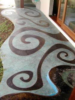 Suelo de cemento pulido con diseño orgánico en acido (acid stain)